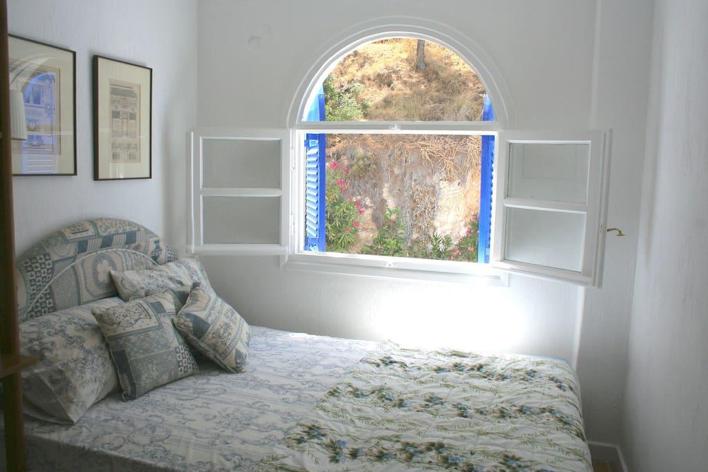 Top floor, second bedroom looking over to the quiet front street (bed fits two)
