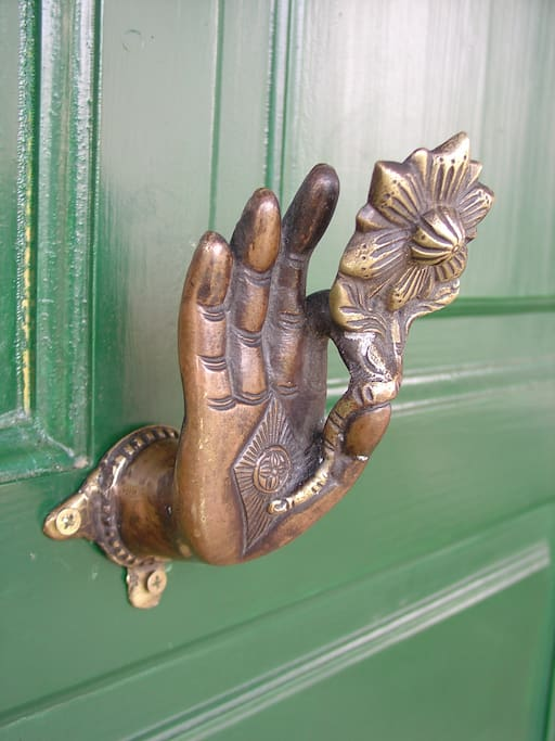 Nice decoration datails are from our travels around the world. This copper hand welcomes you from Nepal.