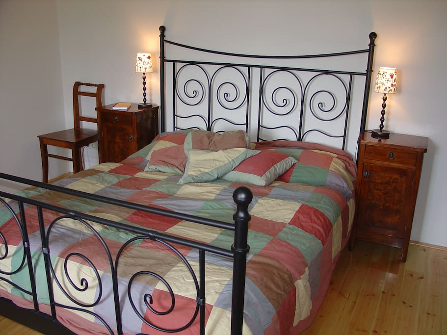 Bedroom with selfmade beddings. Modern and antique goes well together in this house.