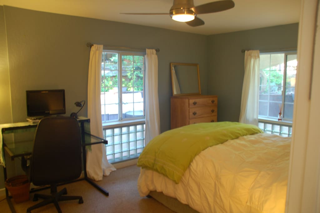 Bedroom includes desk and DVD player with relaxing views