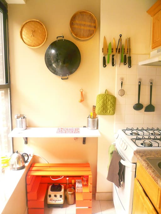 The kitchen is small, yet organized.