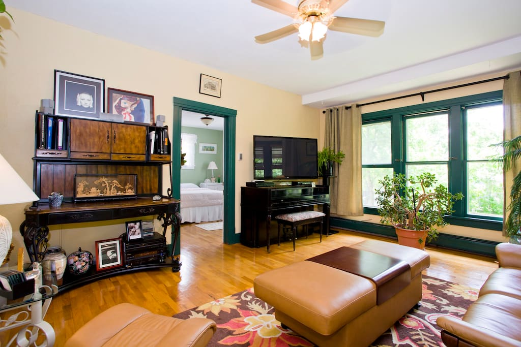 Enjoy watching TV or listening to your favorite music in this uplifting  sunny living room.