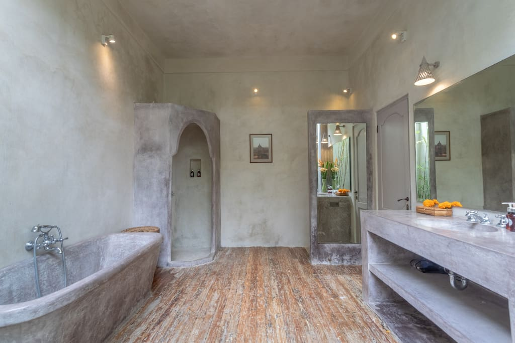 Spacious bathrooms with tub and walk in showers