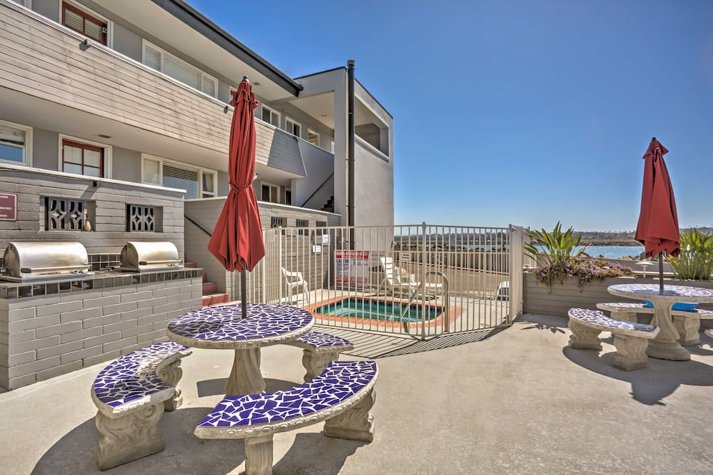 The condo complex offers a community courtyard with a hot tub and gas grills.