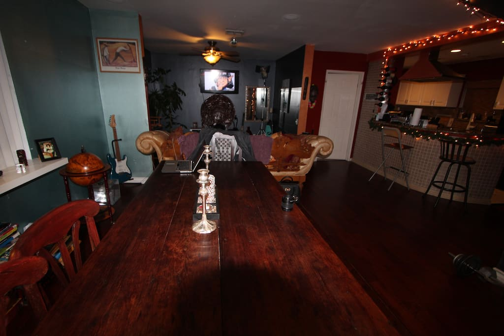Large wooden dinner table for feast with friends.