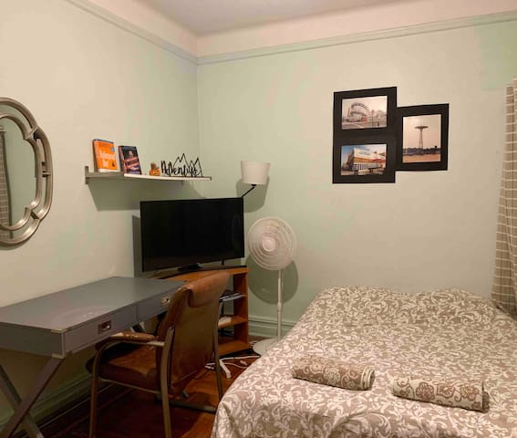 """The futon open and bedded, a 4K 43"""" TV with Netflix included!"""