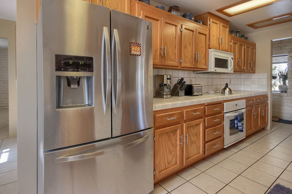 Kitchen is open to the living area and has counter seating for four. Newer appliances include refrigerator, dishwasher, microwave, stove/oven, coffee maker and bean grinder, and all the kitchenware for daily and holiday meal prep.