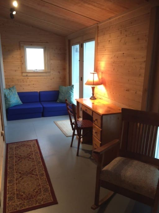 Casual style in the cedar paneled entry. Blue seats fold out for sleeping.