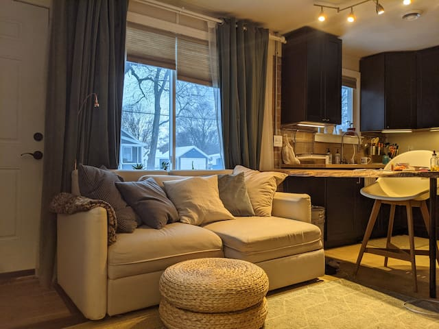 Living Room with Pull out Sofa Bed and storage compartment stocked with extra blankets
