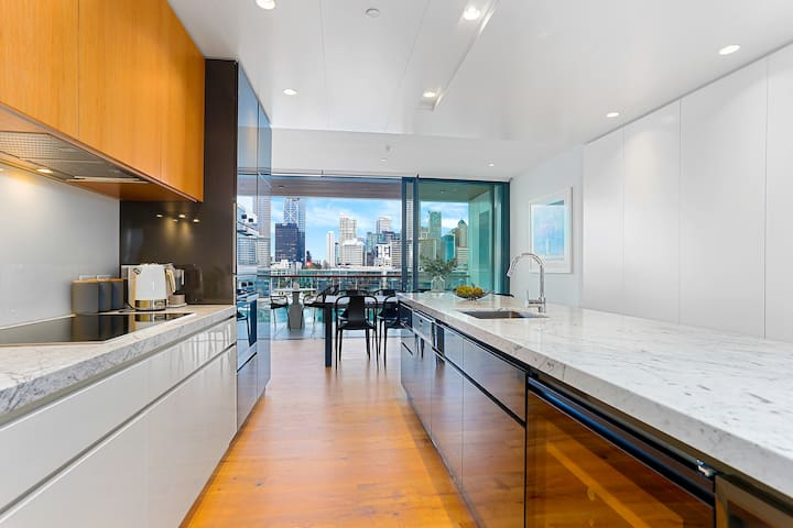 Luxury living with surrounding water views in city