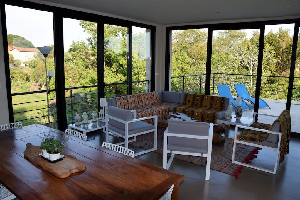 Main living space opens on terrace