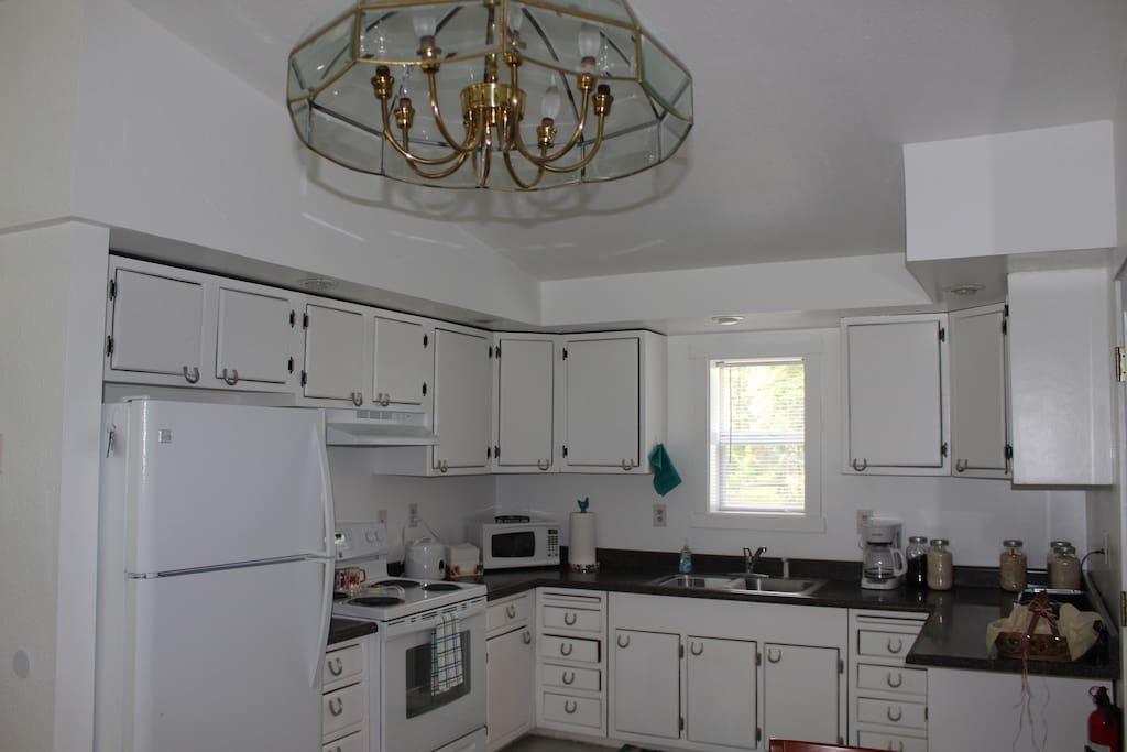 Roomy, well-stocked kitchen