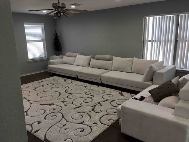 Main living room sofa - accommodates 10+ people. Very large and comfy