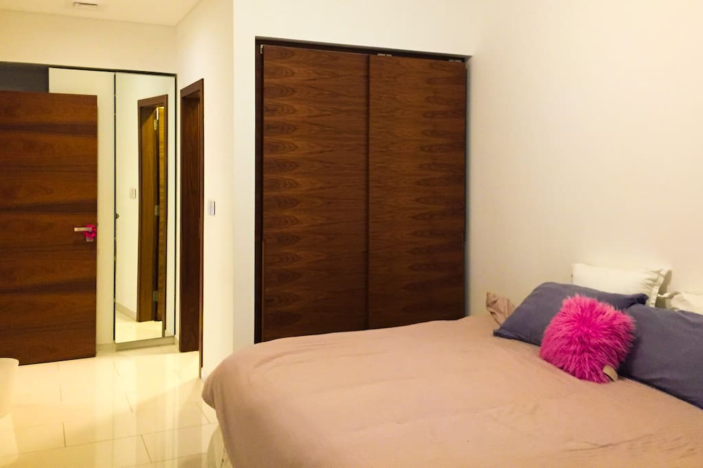 Spacious bedroom with super king sized bed, and en suite bathroom and closets.