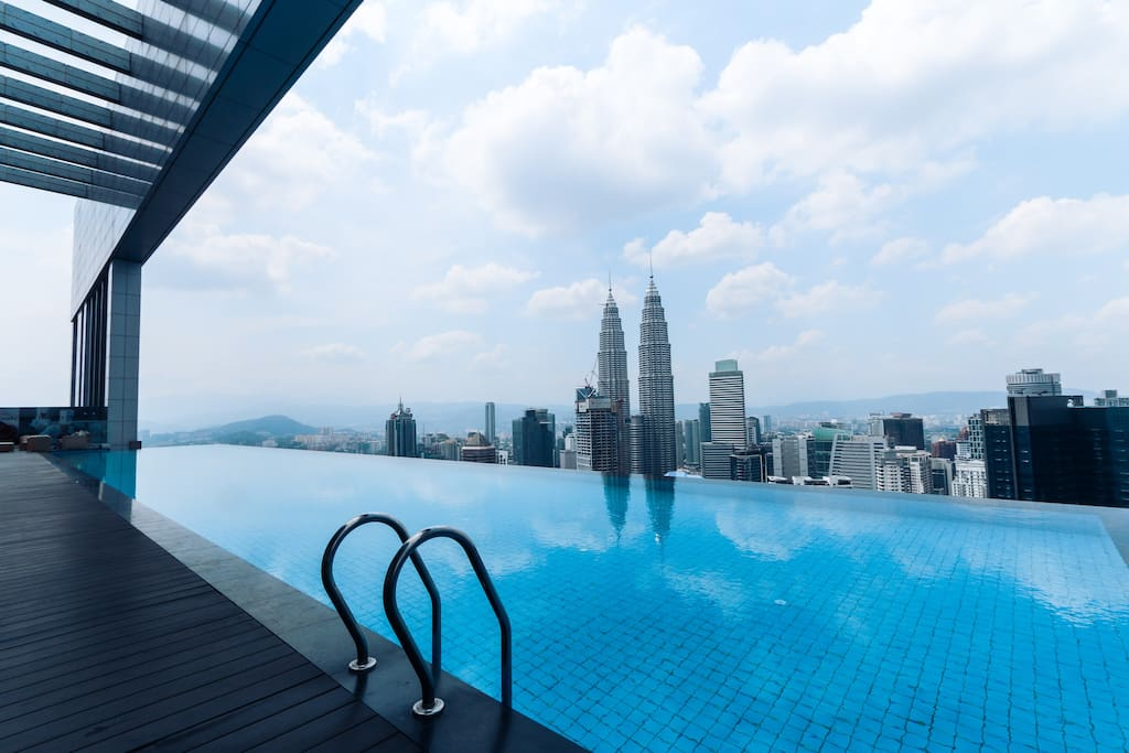 Petronas twin towers and KL Tower look just beside you at the sky deck with infinity pool.