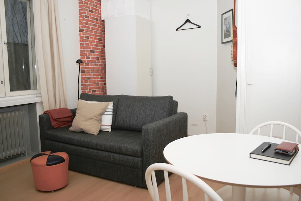 Quiet one-room studio with a quality sofa bed and space to eat and work.