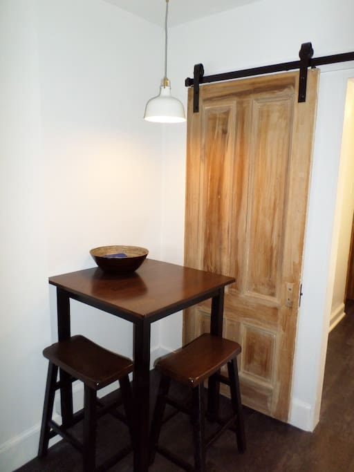 Eating nook with sliding barn door for the bathroom.