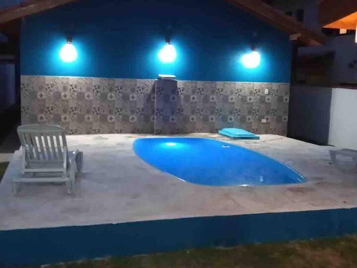 Casa com Piscina em Massaguaçu - RDA 02