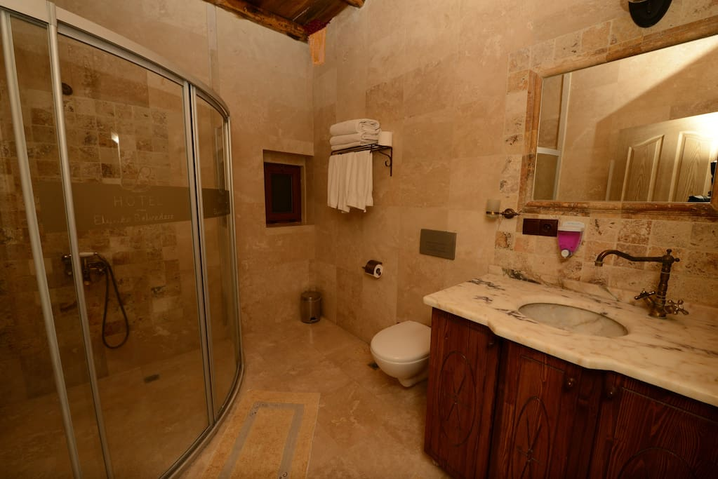 Our bathrooms are quite large and useful with its amenities. Has also elegang marble table and granite tiles.