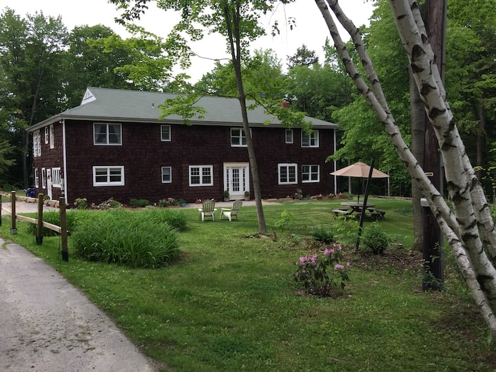 Elegant Forested Farmhouse Retreat