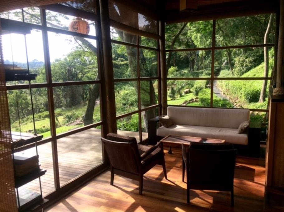 Lounge with views over the formal meditation gardens and rock cliffs of nature reserve