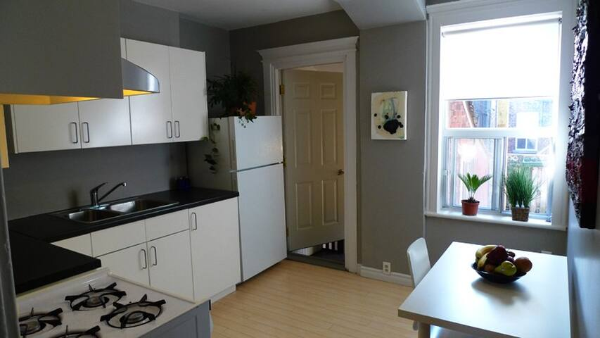 Bright eat-in kitchen with gas stove.