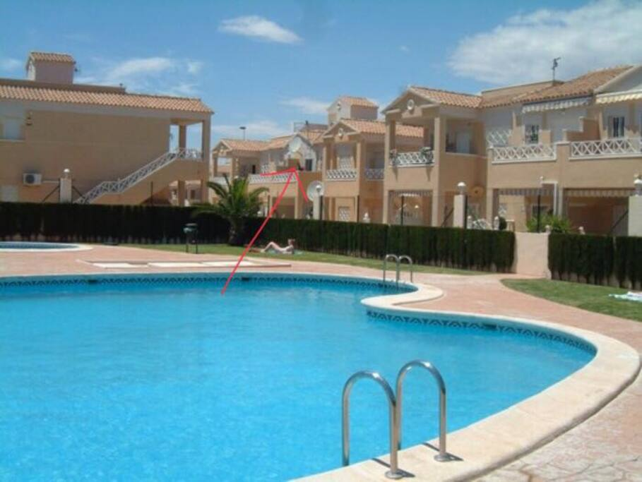 Community pool and casa Craig with red arrow pointing