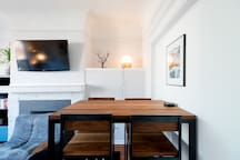 Locally made bar-height table in the bright, shared living room.