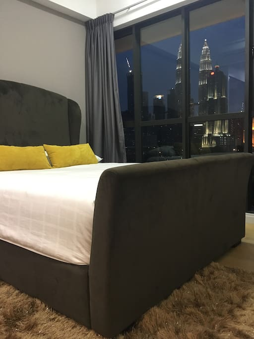 The comfy real bed in a comfortable bedroom with a magnificent view of KLCC