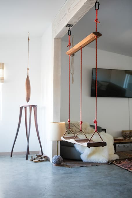 """The """"callais"""" double swing in the great room between the living and dining rooms."""