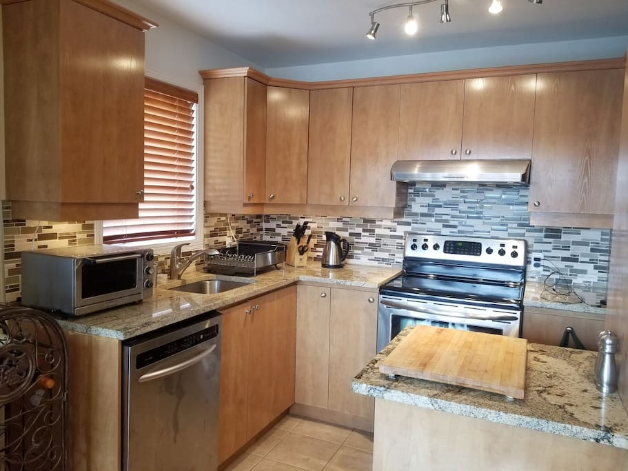 Kitchen with stainless steel high end appliances Granite counter top 1/2