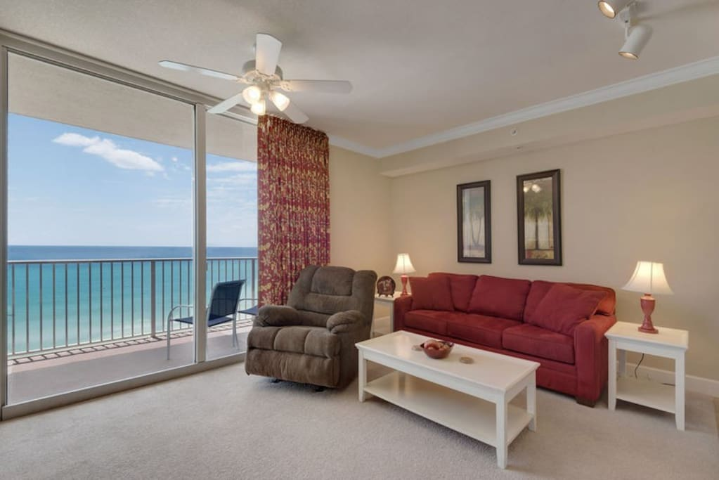 Spacious Gulf front living area featuring a Queen sofa sleeper