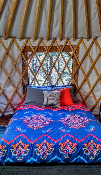 Sleep in the round and watch the stars through the yurt's skylight.