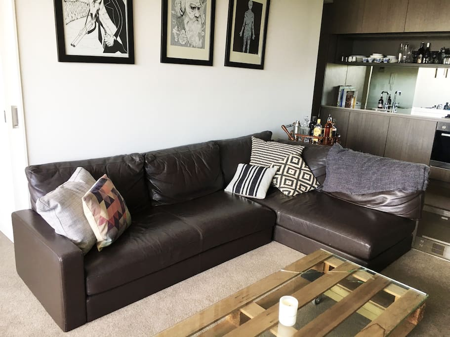 Lounge room with leather sofa, hand made furniture and limited edition art prints.
