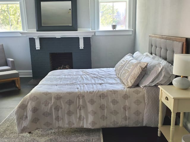 Deluxe Master #1:  Boasts luxury queen bedding, in room fire place, private balcony, mini fridge with coffee for on demand use(main coffee system offered in kitchen), relaxed sitting area, clothes storage, noise reduction/black out curtains & more!