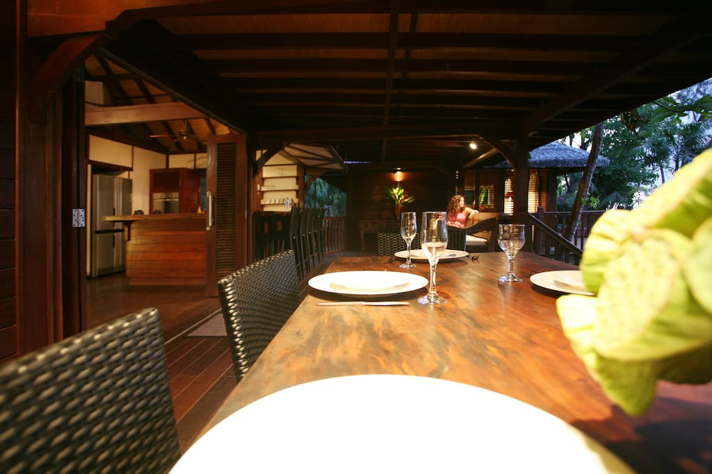 Outdoor  dining space is perfect for relaxed dinners or a drink at the bar