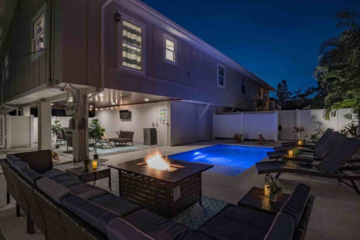 Beach home w/ exquisite backyard - firepit, private heated pool, grill, and TV