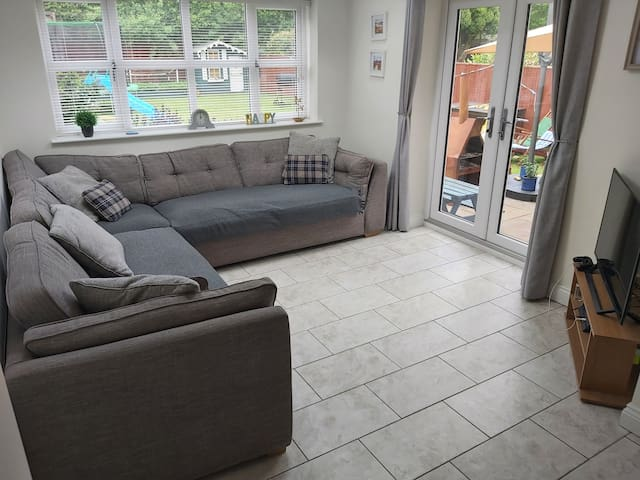 Large corner sofa suitable for two people sleeping (one on each side). 2.8m long each side.