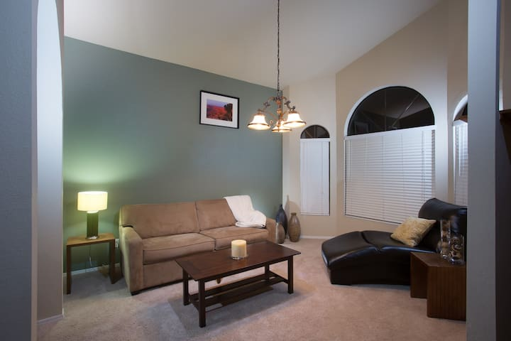 Relaxing room, sofa folds open into a very nice queen size sofa bed, made for you upon arrival.