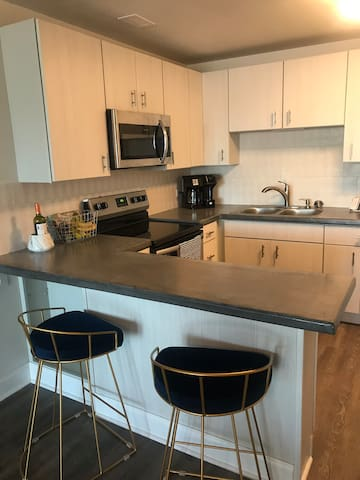 Contemporary 1 BR midtown condo with balcony