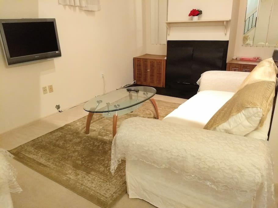 Living Room...golden carpet....white sofa..comfortable, clean...vibrant...positive energy