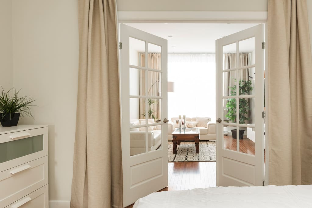 French doors opens on the living room, but gives privacy when needed!