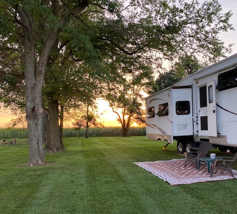 Camper with country setting