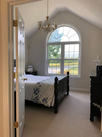 Bedroom with a farm view