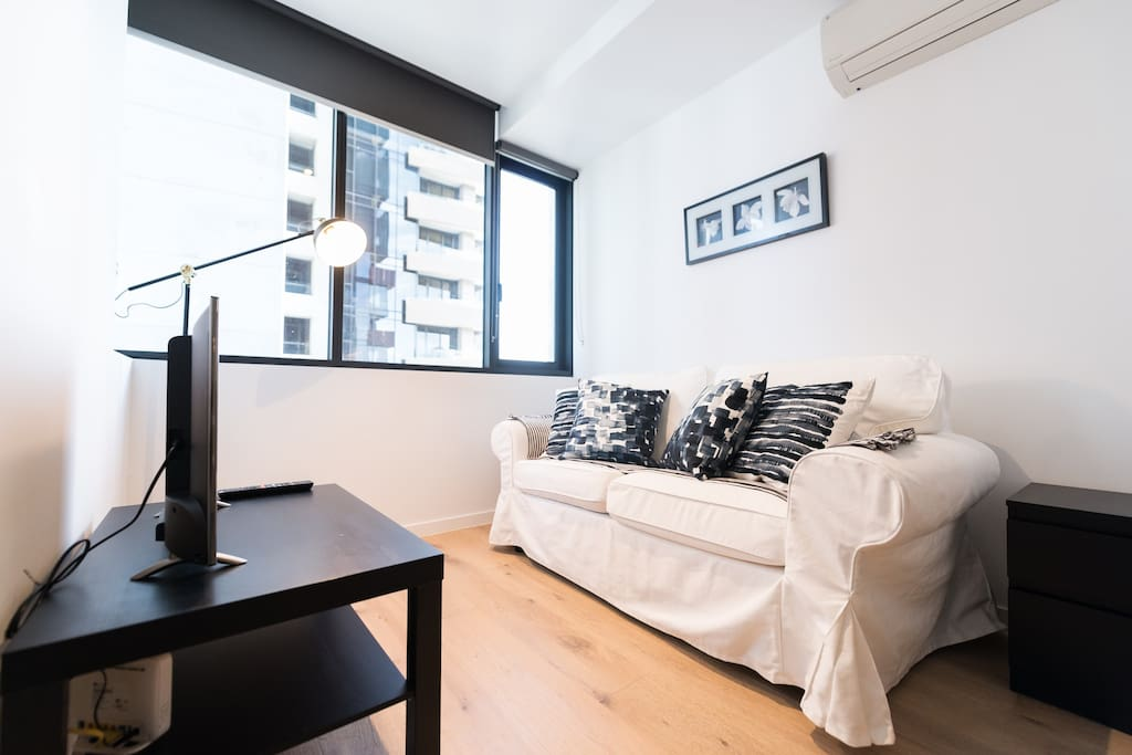 A living area with a comfy 3-seater couch.