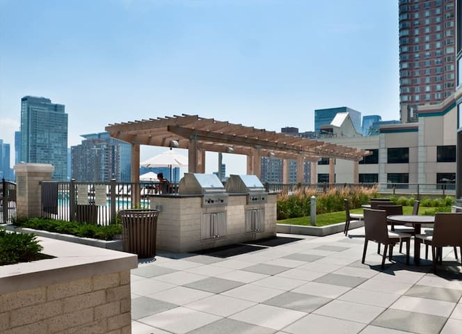 Building amenities include this outdoor grilling space and patio to enjoy at your convenience.