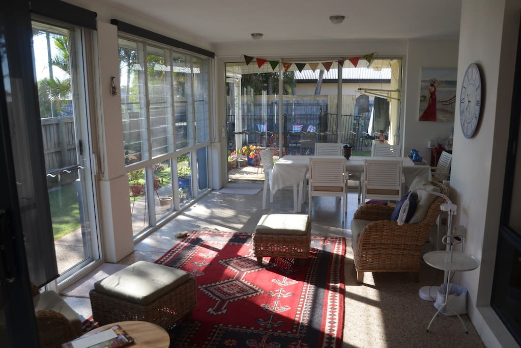 Sunroom with easterly aspect and lovely breezes. All screened. Extendable table and 8 chairs