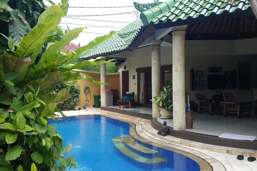 View of the villa and pool as you enter through the Bali door