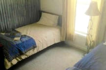 Guest room with two single beds.