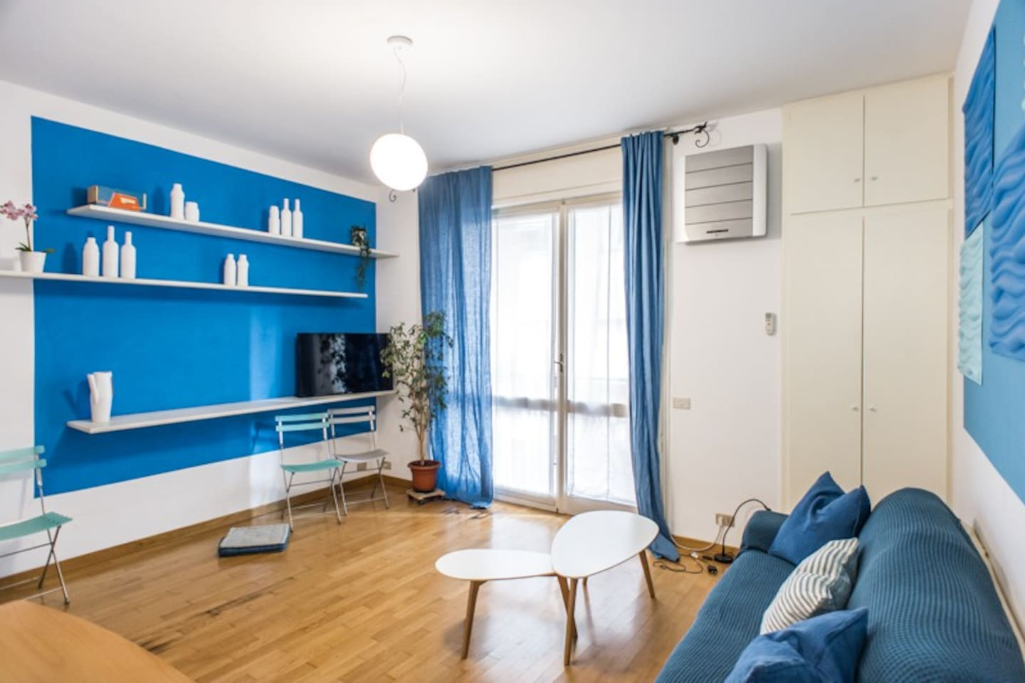 The living room is spacy, bright and finely decorated
